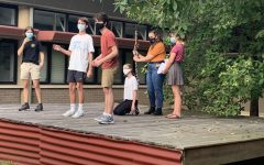 BACK ON STAGE: Students involved in the Fall Shows work together to make the scene come alive. Although students are able to go to school for rehearsals, they must follow COVID-19 safety protocols such as wearing a mask and gloves, and also social distancing when not on stage.
