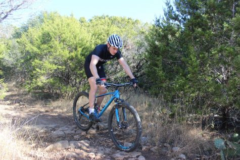 ROCKY ROAD: Liam Spencer practices mountain biking along the Violet Crown Trail in Austin. Spencer began mountain biking with the Bowie team in his freshman year.
