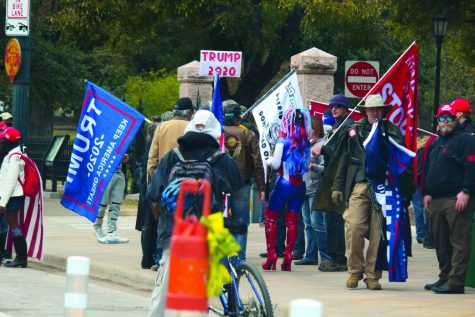 DONT STOP BELIEVING: A group of Trump supporters protest the election results outside of the Texas State Capitol on Dec. 6. Trump and other Republican groups have filed over 40 lawsuits challenging the results of the presidential election.