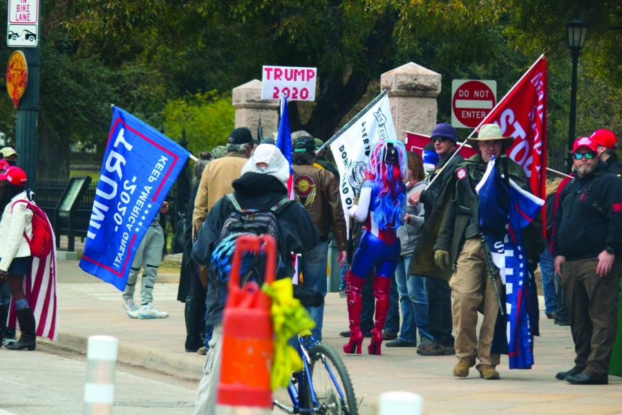 DON'T STOP BELIEVING: A group of Trump supporters protest the election results outside of the Texas State Capitol on Dec. 6. Trump and other Republican groups have filed over 40 lawsuits challenging the results of the presidential election.