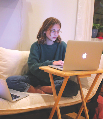 "WORKING HARD: Senior Kaitlyn Muras edits and compiles footage for ""Chester, who painted the world purple"". Muras spent over 24 hours editing for the children's show."
