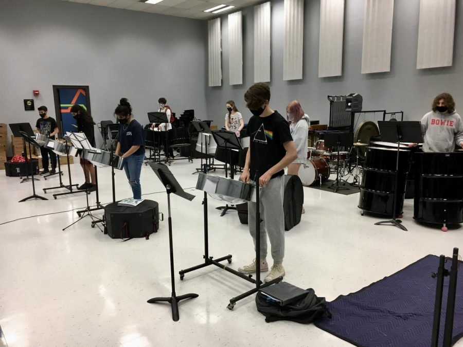 PRACTICING THE SONGS: Students in the steel drums class get together to practice playing their music. This was the first in-person rehearsals that was held and students were given the chance to either stay remote or practice in person.