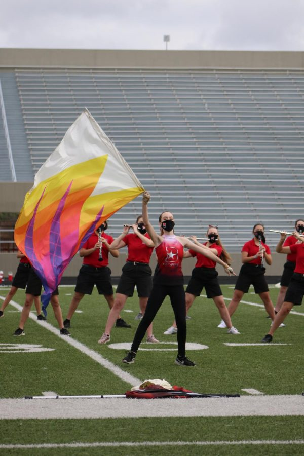 Swinging sabers and twirling flags each performance is just the basics for the Color Guard team. Color Guard students work to achieve the perfect routine, working with the band in the process.