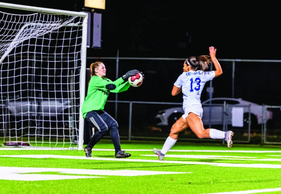 SHE'S A KEEPER: Senior goalkeeper Lauren Spencer makes a save in the match against Ann Richards in the 2019-2020 season. She was the starting varsity goalkeeper, but she chose not to play during COVID-19.