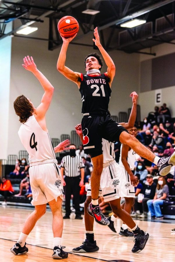 NOTHING BUT NET: Senior varsity member Cade Holzman takes a shot against an opponent in one of the playoff games this year. The team went to three rounds of the playoffs before ultimately being eliminated. PHOTO COURTESY OF HD Flores