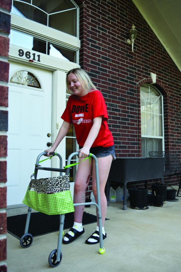 ONE STEP AT A TIME: Senior Grace Pollock is building her strength and working with a physical therapist in hopes of being able to walk and exercise normally once again. She has made tremendous progress since her surgery over Spring Break and is mobile with the help of a walker.