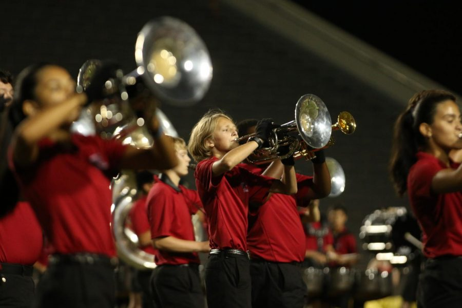 MARCHING ON THE FIELD: The trumpet section performs in the marching bands halftime performance.